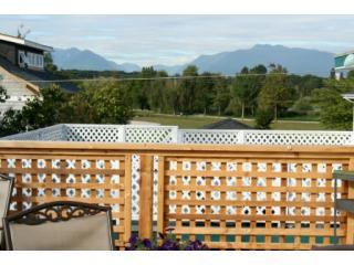 View from deck with BBQ and seating area of Trout Lake and the North Shore Mountains - Tastefully Furnished 3 bedroom Apartment - Vancouver - rentals