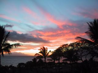 A gorgeous sunset from your lanai - 2 bed 2 bath Luxury Oceanview condo steps to Beach - Maui - rentals