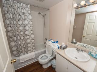 Bathroom with full size bath tub and shower. Towels, Toiletries, Hair Dryer & Bath Mat are provided - Canada Suites - Gorgeous Furnished Condo Apartments in the heart of downtown Toronto - Daily, Weekly and Monthly rates !