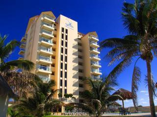 View of Building From Street - Beachfront Salvia Condo Cancun Hotel / Party Zone - Cancun - rentals