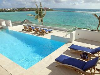 With 2 natural beaches, a tennis court, gym and personal cinema, you and your guests may never leave this villa. LHE BLE - Anguilla vacation rentals