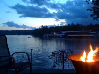 Fire Pit at night - Waterfront Upscale Condo on Paugus Bay, Winnipeasukee, NH w/ private beach - Laconia - rentals