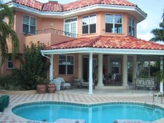 Waterfront Calypso Shores within gated community with pool, full staff & tennis court - Jamaica vacation rentals