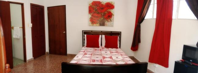 WIDE ANGLE OF THE REDDISH ROOM UNIT - The right choice - at the right location! - San Juan - rentals