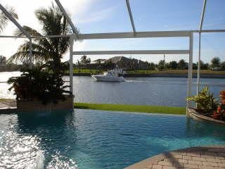 Typical View from the pool area and livingroom - Upscale Villa Retreats I & II Gulf or Golf Access - Cape Coral - rentals