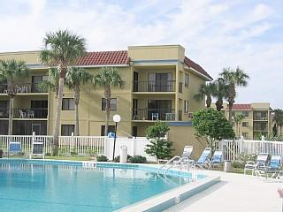 Condo (second floor, corner unit) as seen from heated pool - Oceanside Condo - Beautiful Ocean Village Club - Saint Augustine Beach - rentals