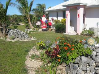 owner in front of Conch Pearl cottage @ Xmas - Nicole Fleming