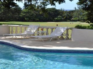 This property, on a corner lot on the upper ridge of Sandy Lane Estate, sits directly above the golf course and has views of the - Barbados vacation rentals