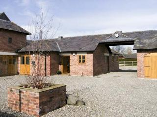 THE BYRE, pet friendly, country holiday cottage, with a garden in Bronington, Ref 5174 - Whitchurch vacation rentals