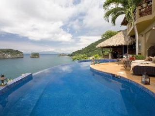 Los Arcos with oceanfront terrace, saltwater infinity pool, infrared sauna - Terres Basses vacation rentals