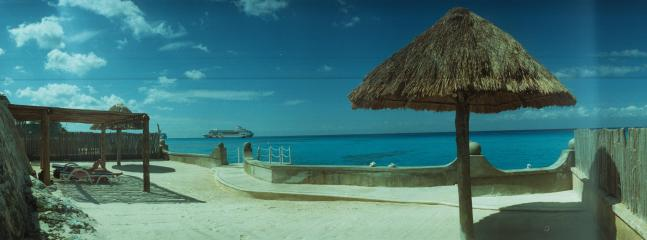 Small condo, lovely sand sunning area and easy dock or ladder access to the best island snorkeling. - BEACHFRONT FOR TWO ALL AMENITIES AT HALF THE PRICE - Cozumel - rentals