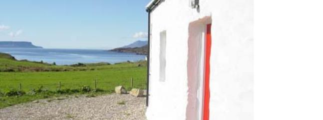 Front of house & view to Eigg - The Old Croft House - Ardvasar - rentals