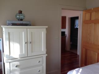 Master bedroom with cable TV and DVD. - The Moxie Oceanfront Luxury Cottage