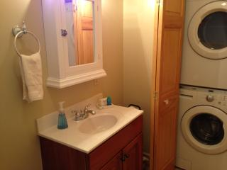 Full bathroom with washer/dryer. - The Moxie Oceanfront Luxury Cottage
