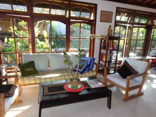 Sitting area next to windows with view to gardens, pool & bale - Angel Villa Bali
