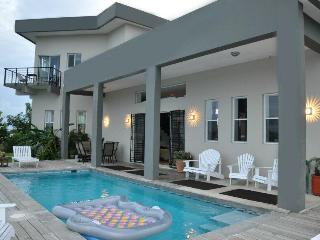 Waterfront home, private pool, and FREE vehicle with property - Belize District vacation rentals