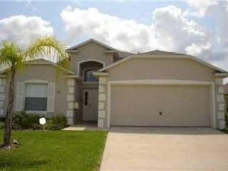 4 BED 3 BATH HOME WITH POOL & SPA - 2 MASTERS - GATED COMMUNITY - Davenport vacation rentals