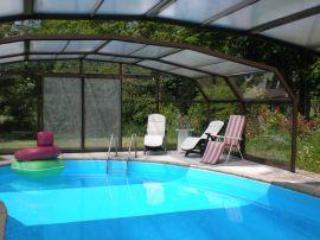 covered swimming pool with telescopic opening sections and loungers to relax on. - Rolles Court - Dover - rentals