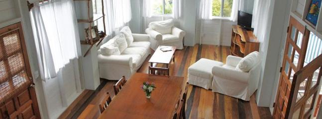 The bright and airy living and dining room opens to a front and back veranda - The House of Sea Dreams - Luxury 3BR 2BA Sea View - Caye Caulker - rentals