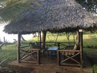 outdoor hut and furniture - Consolata Bryant