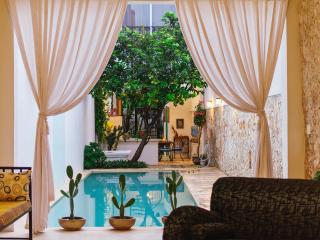 Contemporary chic and great pool meets old world charm - Merida vacation rentals
