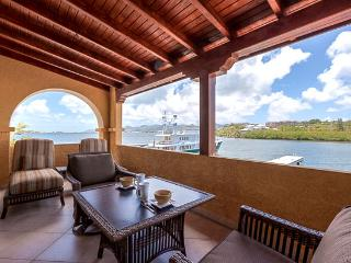 St. Martin Villa 164 On The Entire Top Floor Of A 2 Story Building And Has 3 Waterfront Terraces. - Cupecoy vacation rentals