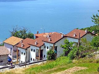 Design lake apt with pool and lake view - Montemezzo vacation rentals
