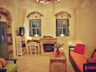 Myrtia House, colorful stonebuilt house in village - Koskinou vacation rentals