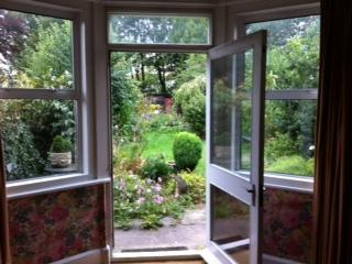 French doors from living room to garden all on one level - Smuggler's Cottage in vibrant seaside town - Red Cloud - rentals