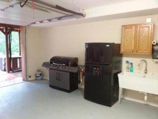 2nd Floor garage with two stainless steel grills; refrigerator with ice maker and wash sink  - Andy Wells