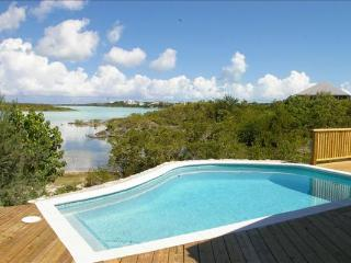 Located directly on Chalk Sound, this villa is a 1-minute walk to Sapodilla Bay Beach. IE SRV - Providenciales vacation rentals