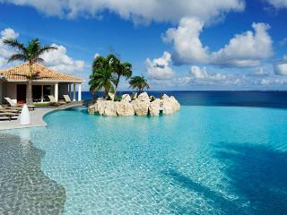 St. Martin Villa 21 Featured Is A Huge Shallow-entry Heated Pool With A Jacuzzi And A Very Large Deck For Sunbathing. - Terres Basses vacation rentals