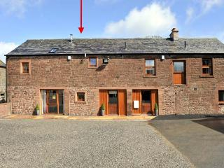 THE OLD GRAINSTORE, family accommodation, character features, woodburner, en-suite bedroom, near Wigton, Ref 18931 - Cumbria vacation rentals