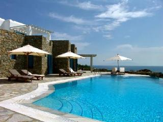 Eros overlooking the Bay of Agios Lazaro with infinity pool, helipad & dock access - Tourlos vacation rentals