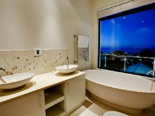 Sleek multi-level Central Drive offers ocean views, infinity pool & alfresco shower - Cape Town vacation rentals