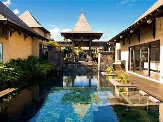 Cassiopee 16 offers a stunning overflow pool, tropical garden and housekeeping - Mauritius vacation rentals