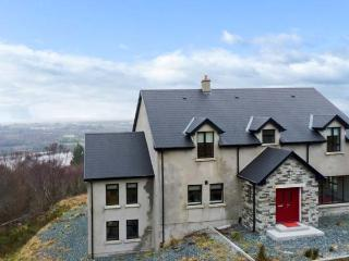 GWEEBARRA HOUSE, detached property, river views, open fire, sun room, games room, near Lettermacaward, Ref 23560 - County Donegal vacation rentals