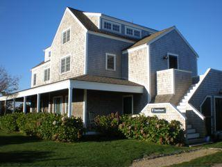 Farmer's porch is surrounded by blue hydrangea - QUIDNET NANTUCKET - Beautiful large newer home - Acushnet - rentals