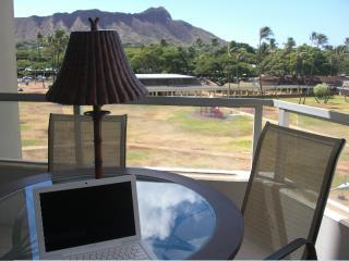 main lanai - enjoy your meals overlooking the school yard crowned with Diamond Head! - BEST in Waikiki 2 BDRM Diamond Head Vista Honolulu - Honolulu - rentals