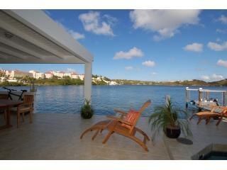 View of the terrace & lagoon from the lounge doors. BBQ area on left, swimming pool on right. - Waterfront, private pool, perfect romantic retreat - Saint Martin-Sint Maarten - rentals