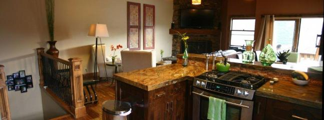 Wide angle view of the kitchen, with the living room beyond it - Luxury 2-Family Home - All New Furnishings in 2012 - Park City - rentals