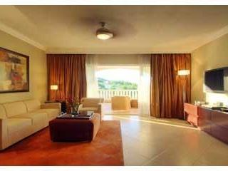 Livingroom with expansive balcony. Great place to watch the sky brighten each morning - Luxurious Two Bedroom -Dominican Republic - Puerto Plata - rentals