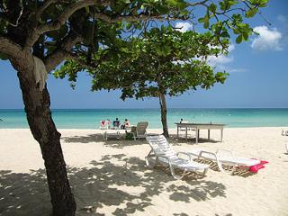 relaxing on the beach - Negril vacation rentals