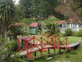 Cottages set in quiet gardens with sea views - Pohara vacation rentals