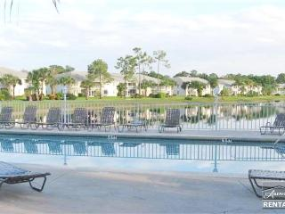 Lovely lakefront coach home with fresh tropical decor just minutes from beach - Naples vacation rentals