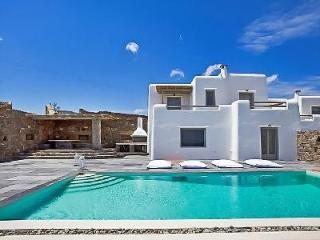 Modern Poseidon One with 3 stone façade villas, superb bay views & infinity pool - Kalafatis vacation rentals