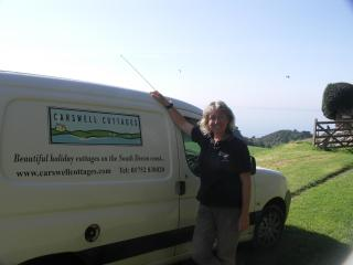 Katherine with the Carswell Cottages van looking out over to the South Devon coast. - Mrs Katherine Harding