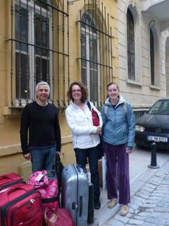 Tarkan helping guests with luggage after their stay - Julia and Tarkan