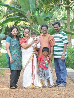 Coconut creek kumarakom bed and breakfast host family - ullas babu