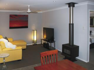 Lounge area with wood heater for the winter months. - Maric Park Cottages